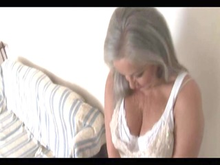 Busty attractive granny in open girdle and