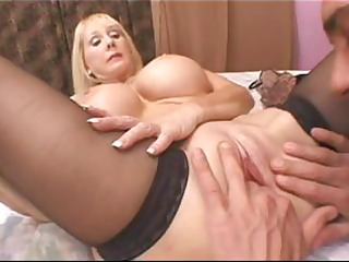 blond granny with big fake whoppers munches on