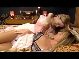 blond beauty in robed giving a kiss fingering