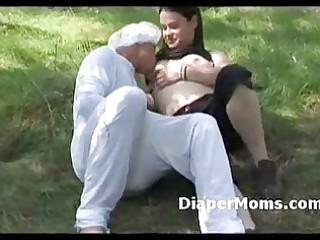 dark brown mamma breast feeds adult baby in