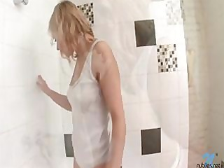breasty blonde bathes in white cotton wife beater