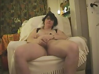 older monica masturbates with glass sex-toy and