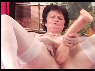 granny in white stockings plays with large toys