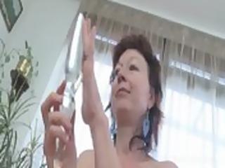 older redhead masturbates with glass dildo