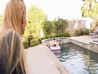 giant titted wife teasing her spouse by the pool