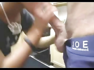 wife gives blowjob in the kitchen