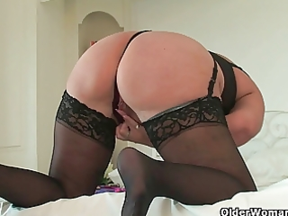 curvy granny in darksome stockings rubs her old