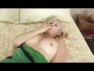 golden-haired granny plays with herself