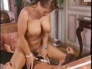 older brunette hair with large boobies receives