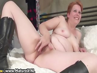 aged mama laying on the bed and rubbing part1