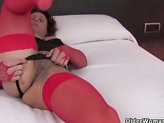 sexy granny in nylons rubs her curly wet crack