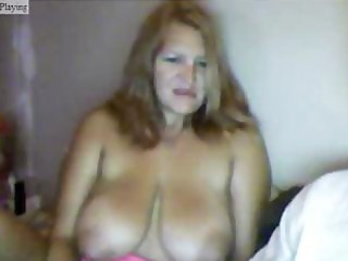 overweight aged golden-haired sits topless at the