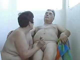 aged wife jerking off husband outside