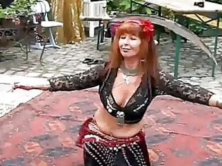 aged redhead stomach dance
