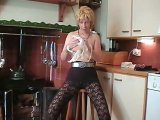 british golden-haired older does a striptease and