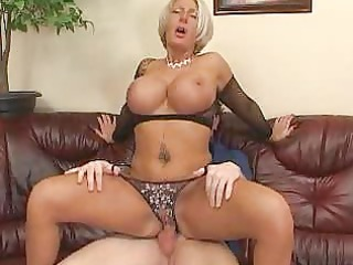 breasty mature golden-haired in darksome fishnet
