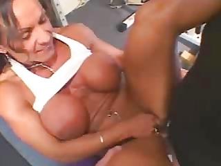 sexy aged breasty brunette bodybuilder
